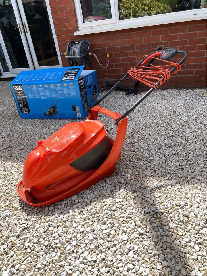 Comparing hover mowers with wheeled lawn mowers for grass cutting ability and value for money